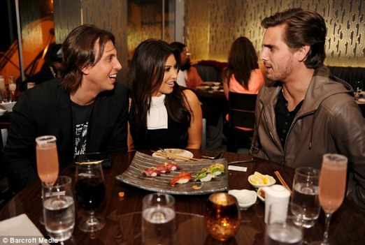 Kim Kardashian alongside friends Jonathon Cheeban and Scott Disick enjoying a platter of sushi. Photo Courtesy of Daily Mail.